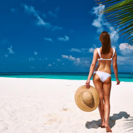 girl in a hat: Woman in bikini on a tropical beach at Maldives
