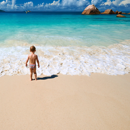 two year old: Two year old baby boy playing on beach at Seychelles