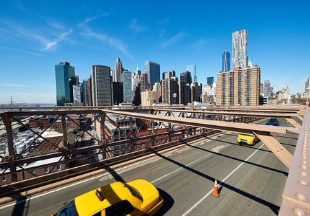 taxi famous building: Lower Manhattan skyline view from Brooklyn Bridge in New York City. No brandnames or copyright objects. Stock Photo