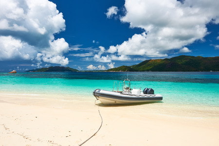 inflatable boat: Tropical beach at Seychelles with inflatable boat