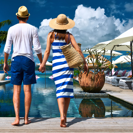 Couple near poolside jetty at Seychelles photo