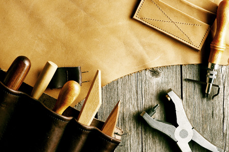 leather texture: Leather crafting tools still life