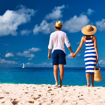 Couple on a tropical beach at Seychelles, La Digue photo