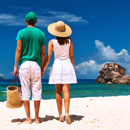 Couple relaxing on a tropical beach at Seychelles, La Digue. photo