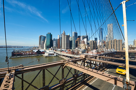 lower manhattan: Lower Manhattan skyline view from Brooklyn Bridge in New York City. No brandnames or copyright objects. Stock Photo