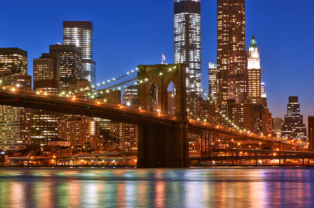 Brooklyn Bridge with lower Manhattan skyline in New York City at night photo