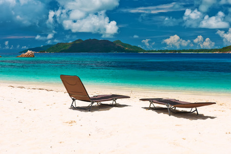 chaise lounge: Tropical beach at Seychelles with chaise lounge Stock Photo