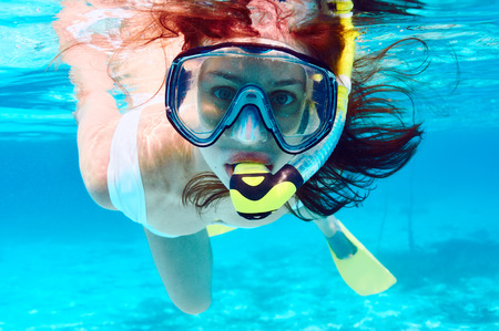 underwater sport: Woman with mask snorkeling in clear water Stock Photo