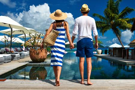 Couple near poolside jetty at Seychelles photo