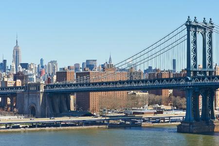 Manhattan Bridge and skyline view from Brooklyn Bridge in New York City photo