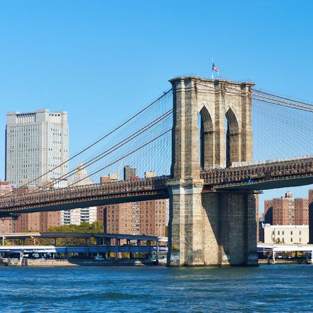 Lower Manhattan skyline and Brooklyn bridge in New York City photo