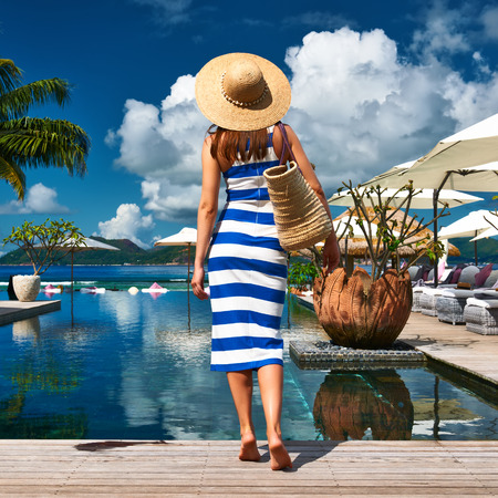 Woman in sailor striped dress near poolside jetty at Seychelles photo