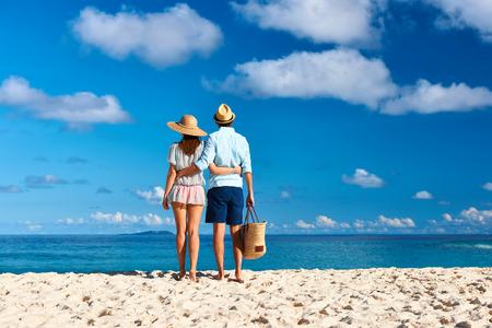 Couple on a tropical beach at Seychelles, La Digue photo