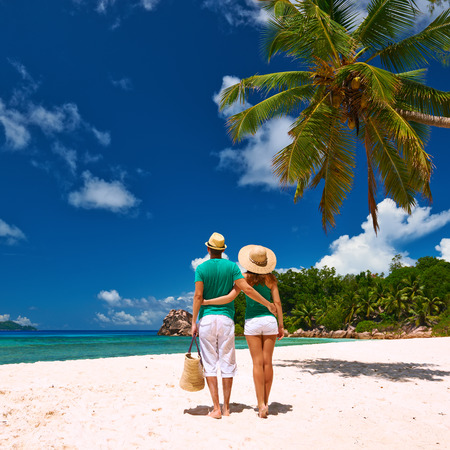 digue: Couple relaxing on a tropical beach at Seychelles, La Digue.