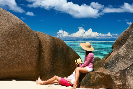 d'argent: Couple relaxing among granite rocks on a tropical beach Anse Source dArgent at Seychelles, La Digue.