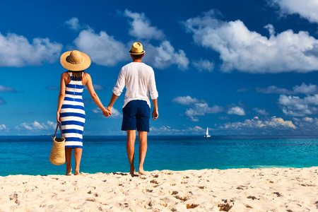 la digue: Couple on a tropical beach at Seychelles, La Digue Stock Photo