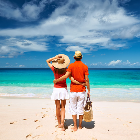 Couple relaxing on a tropical beach Anse Intendance at Seychelles, Mahe. photo