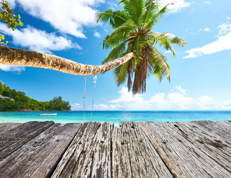 Beautiful beach at Seychelles and old wooden pier photo