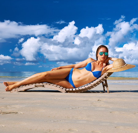 fit girl: Woman in bikini lying on tropical beach at Seychelles Stock Photo