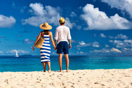 holiday destination: Couple on a tropical beach at Seychelles, La Digue Stock Photo