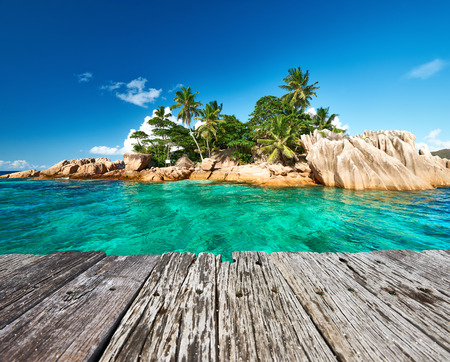 pierre: Beautiful St. Pierre Island and old wooden pier at Seychelles Stock Photo