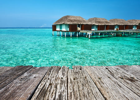 old pier: Beautiful beach with water bungalows and old wooden pier at Maldives
