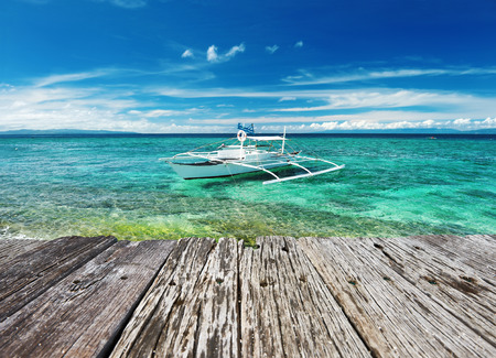 Beautiful beach with boat at Balicasag island, Philippines photo