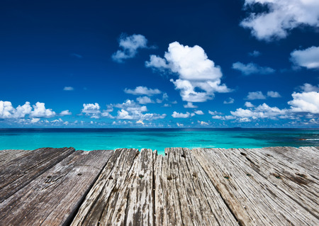 digue: Beautiful beach and old wooden pier at Seychelles, La Digue