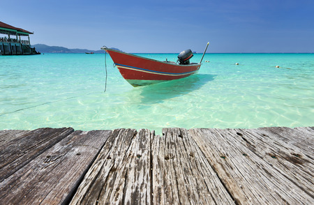 beach cruiser: Beautiful beach with motor boat at Perhentian islands, Malaysia Stock Photo