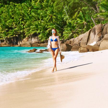 sarong: Woman with sarong on beach Anse Intendance at Seychelles, Mahe Stock Photo