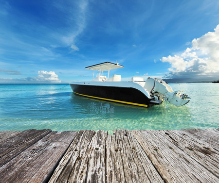 power boat: Beautiful beach with motor boat at Boracay island, Philippines