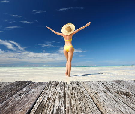 outstretched arms: Girl on a tropical beach with outstretched arms Stock Photo