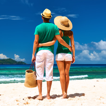 embracing couple: Couple relaxing on a tropical beach at Seychelles, La Digue.