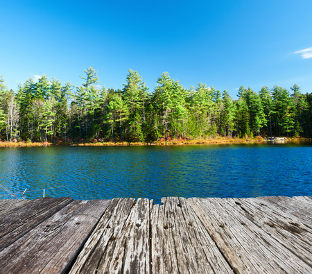 wooden dock: Pond in White Mountain National Forest, New Hampshire, USA.