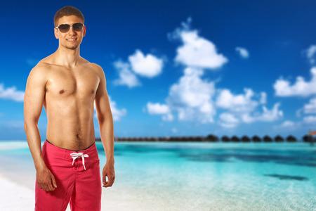 Man on island beach at Maldives. Collage. photo