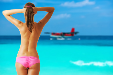 sexy topless women: Woman topless on beach with twin otter seaplane at Maldives. Collage.