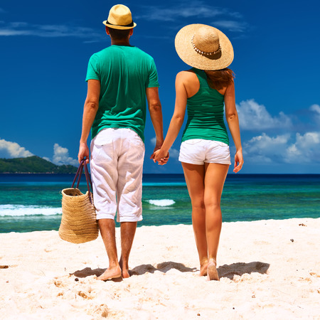 couple relaxing: Couple relaxing on a tropical beach at Seychelles, La Digue.