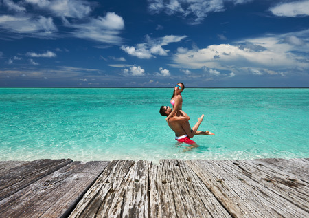 holiday destination: Couple on a tropical beach at Maldives