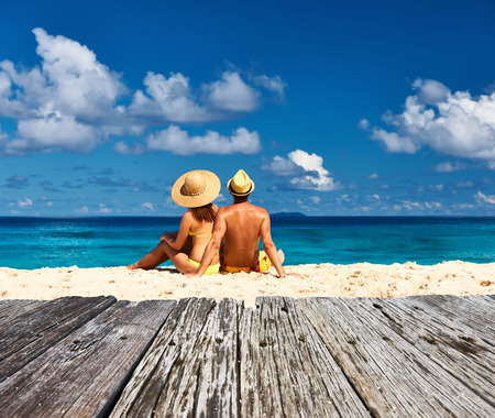 Couple on a tropical beach at Seychelles, La Digue 스톡 콘텐츠