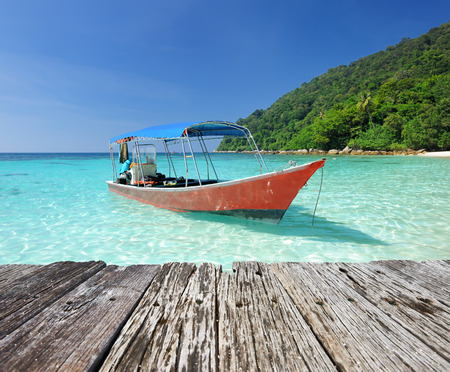 malaysia: Beautiful beach with motor boat at Perhentian islands, Malaysia Stock Photo