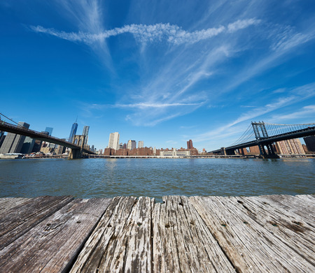 manhattan bridge: Manhattan skyline view from Brooklyn between Brooklyn Bridge and Manhattan Bridge in New York City Stock Photo