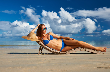 sensual: Woman in bikini lying on tropical beach at Seychelles Stock Photo