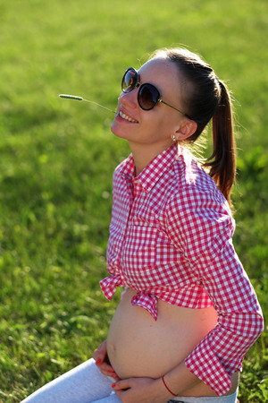 people happy: Pregnant woman outdoors at sunny summer day