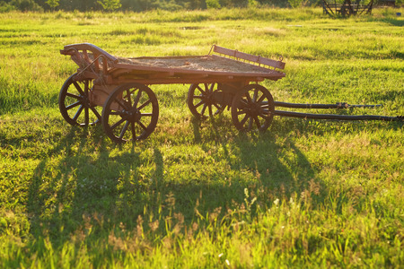 old wood farm wagon: Rural landscape with old wooden cart Stock Photo