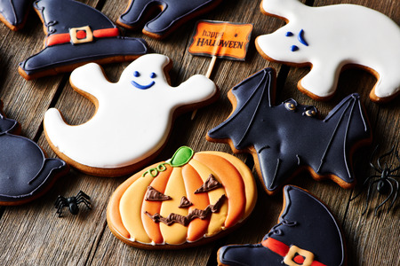 holiday cookies: Halloween homemade gingerbread cookies over wooden table Stock Photo