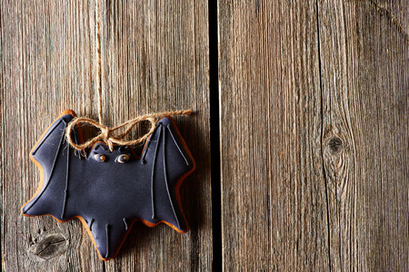 Halloween homemade gingerbread cookie over wooden background Stock Photo