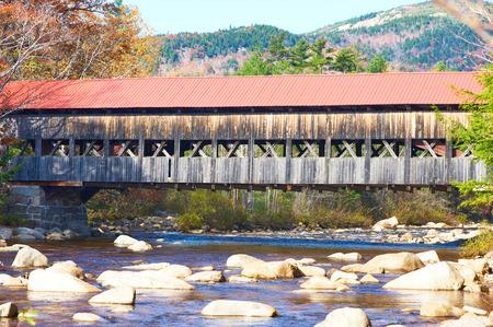 hampshire: Swift River and old covered bridge at autumn in White Mountain National Forest, New Hampshire, USA. Stock Photo