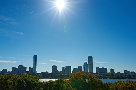 boston skyline: Boston skyline view with sun backlight from Cambridge at Massachusetts, USA Stock Photo