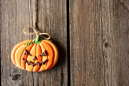 cake background: Halloween homemade gingerbread cookie over wooden background Stock Photo