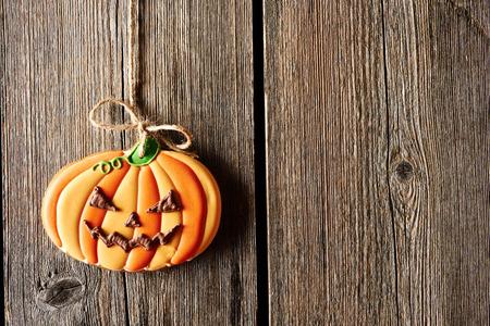 halloween lantern: Halloween homemade gingerbread cookie over wooden background Stock Photo